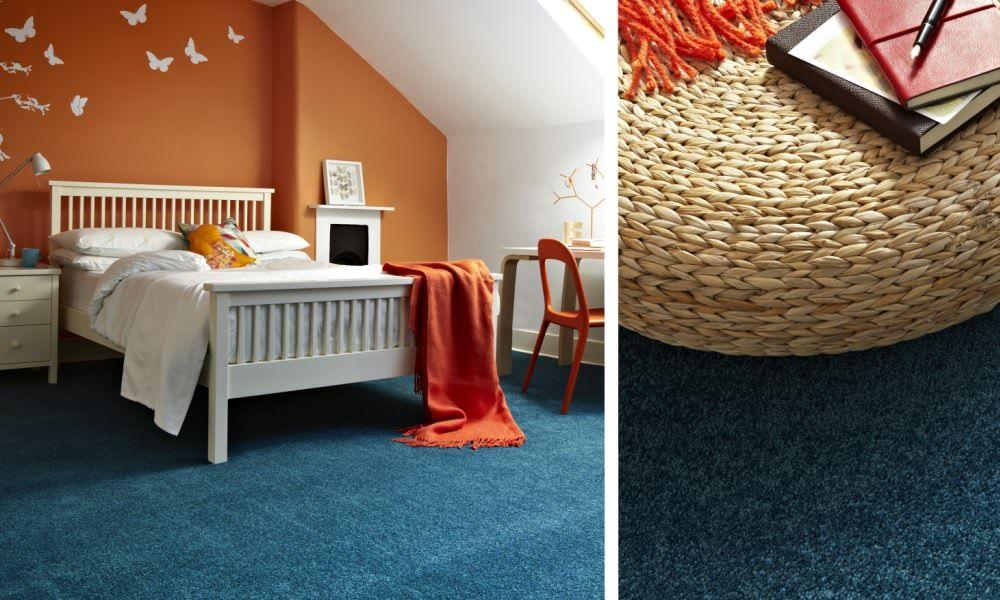 Beautiful blue carpet and orange wall, white furniture