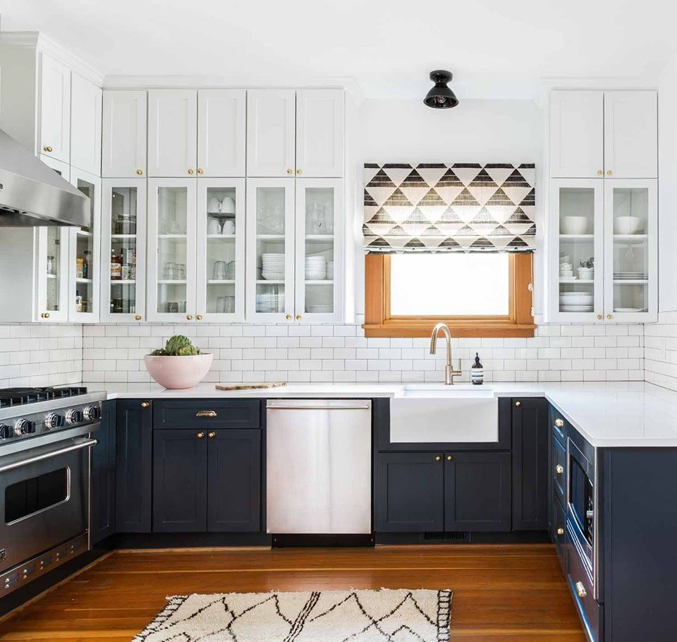 Mixing Two Different Cabinet Colors May Sound Scary At First But The Contrast And Dimen Navy Kitchen Cabinets Kitchen Cabinet Design Two Tone Kitchen Cabinets