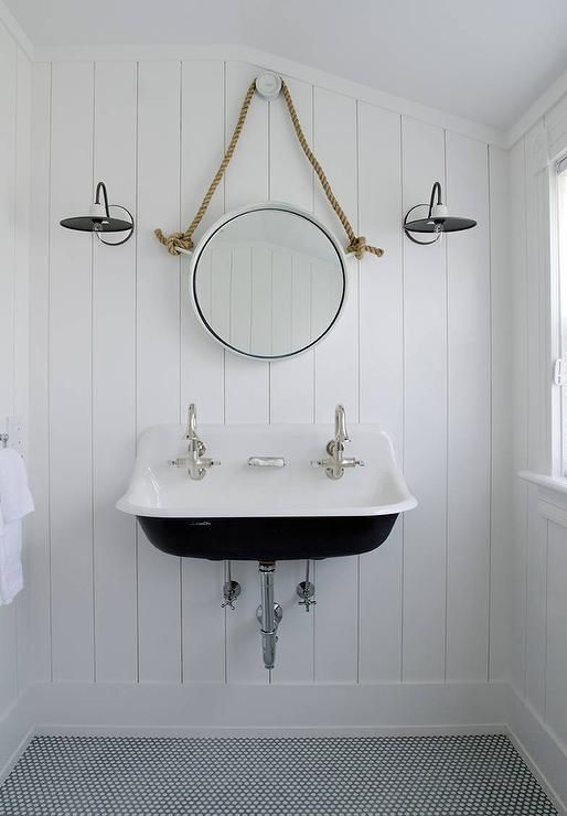 Black And White Cottage Bathroom Features Walls Clad In Vertical Shiplap  Lined With A Rope Hung Mirror Illuminated By Black And White Vintage Barnu2026