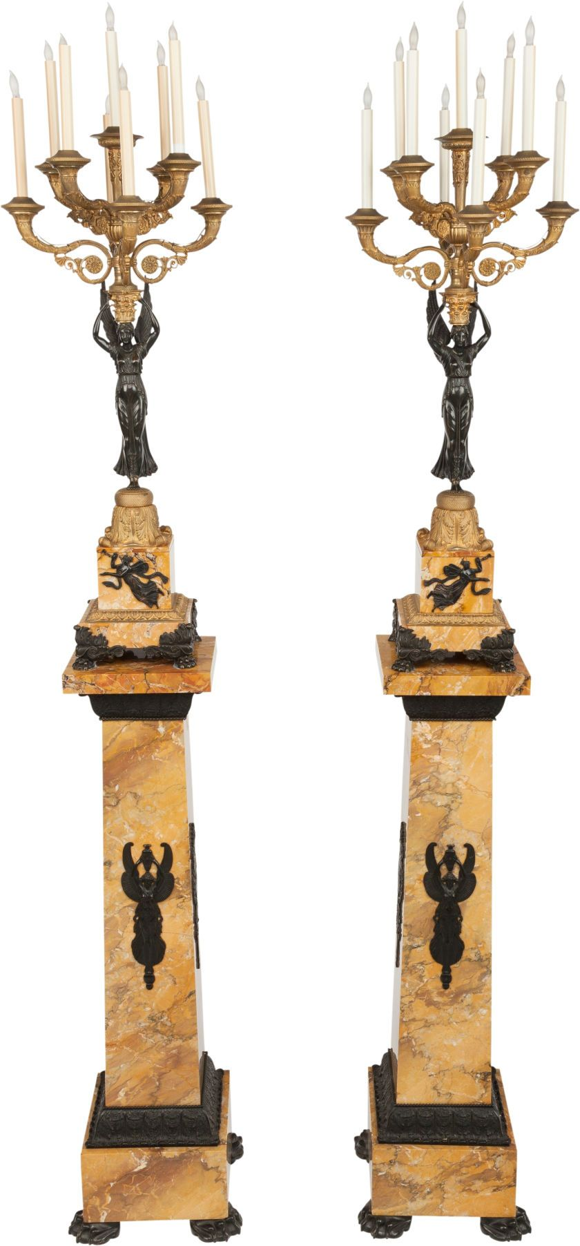 A PAIR OF EMPIRE-STYLE PATINATED AND GILT BRONZE SIX-LIGHT CANDELABRA ON MARBLE PEDESTALS, 20th century.