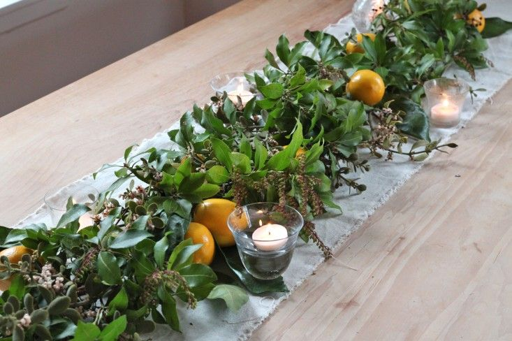 mistletoe meyer lemon garland, finished with candles, by Justine Hand for Remodelista