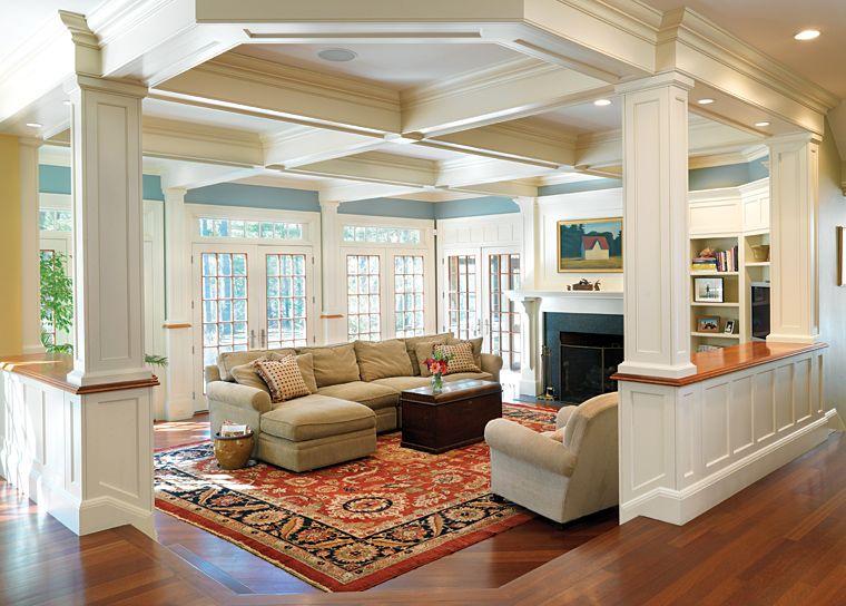 Sunken family room, coffered ceilings, hardwoods, builtins, windows, columns.