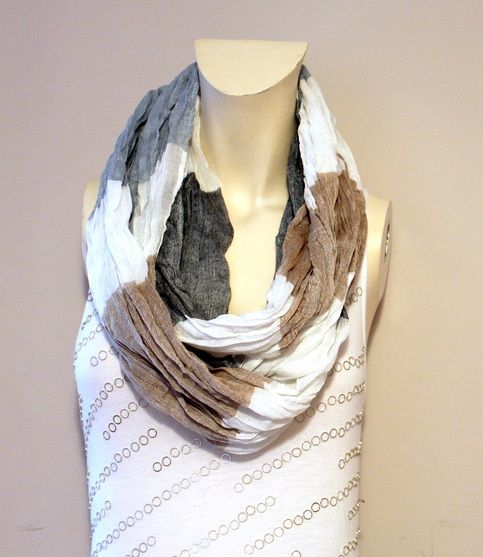 "Taupe Color Block Infinity Scarf:  - Made with 100% Polyester  - Laying flat measures 36"" by 20"" PERECT SCARF"
