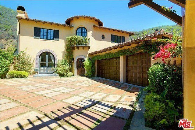 Lauren Conrad has come a long way since her MTV reality days, just recently purchasing a Pacific Palisades mansion in LA. Ivy-covered and charming, the home was built in 2004.