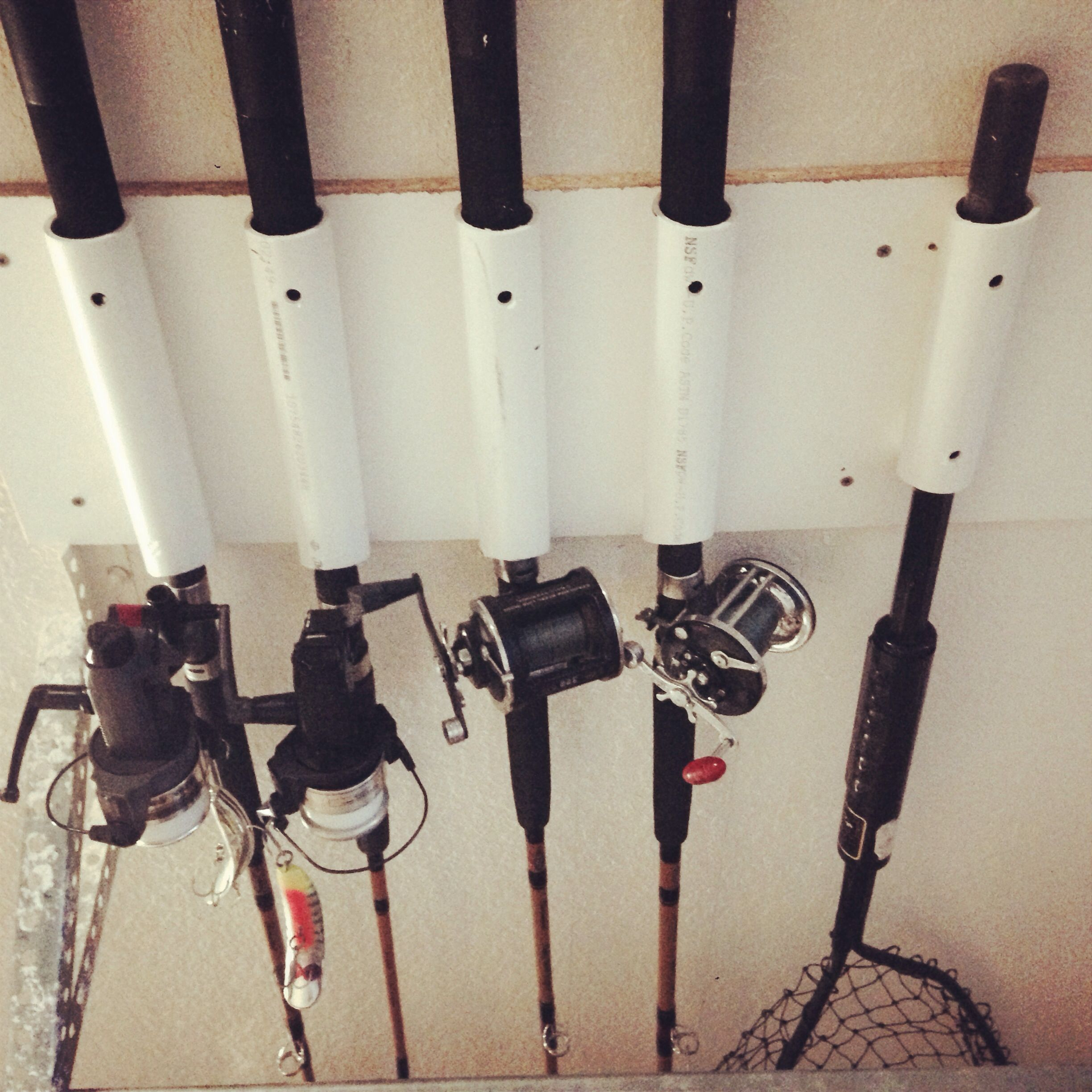 Garage ceiling fishing rod storage by Aaron