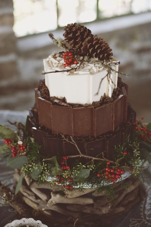Chocolate Love vs Cake Love | A Rustic Wintery Woodland Wedding Cake of CHOCOLATE - Yum - three layers from dark to white chocolate, sat a top of piles of branches, and decorated with ivy, red berries, lichen covered twigs and pines cones, just captures the whole spirit of winter.