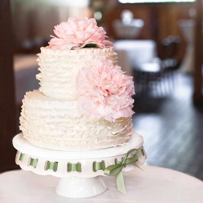 White, ruffled wedding cake with pink peonies | Photo Love Photography