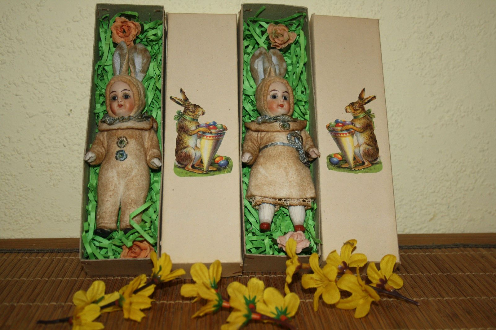 2 Easter Bunny dolls made of porcelain in a cardboard box