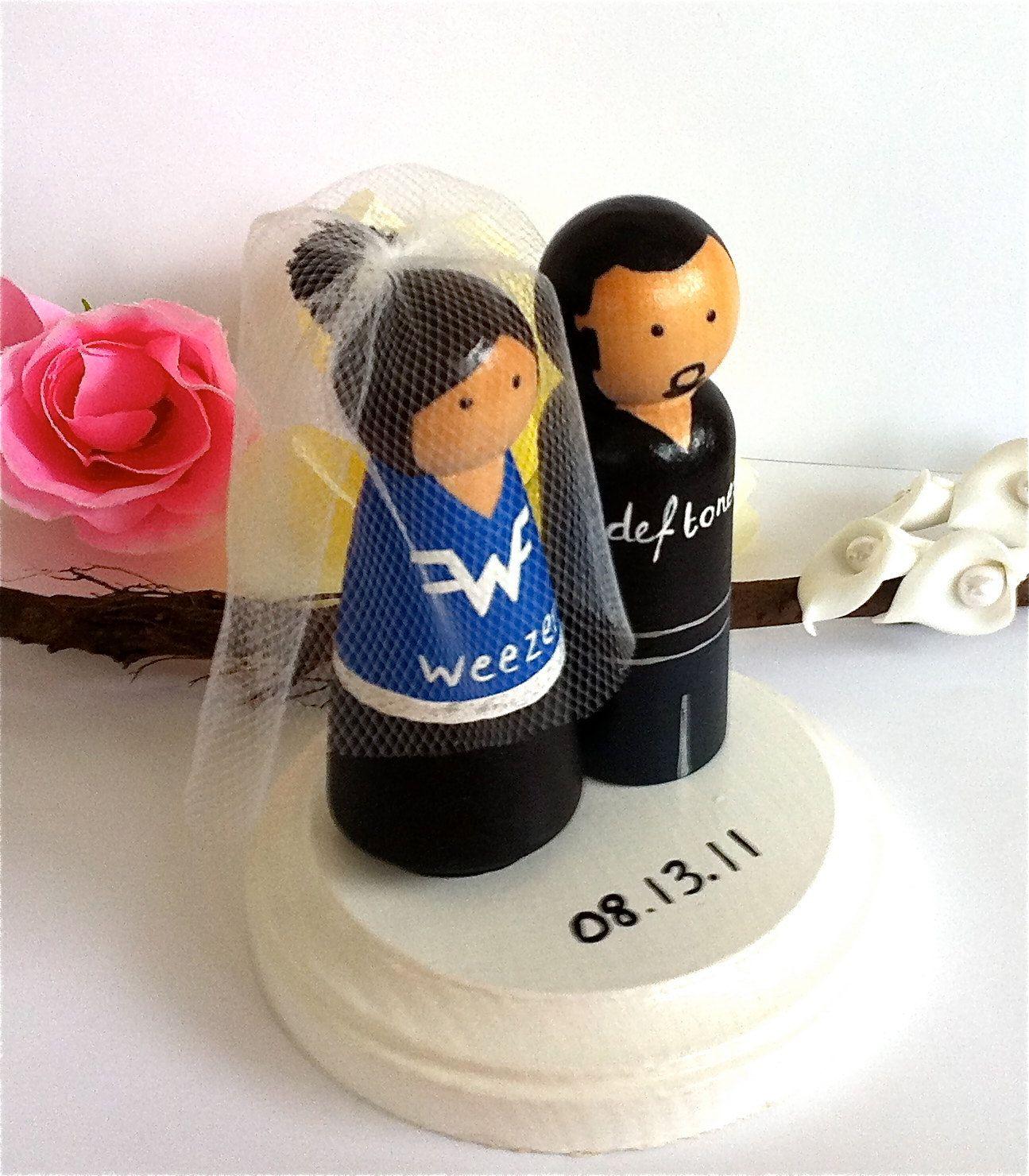 Rocker Wedding Cake Toppers Rock Star Bride Groom Music Deftones Beatles Punk Rock N Roll Rap T Shirts Wood Peg Dolls Personalized Keepsake. $70,00, via Etsy.