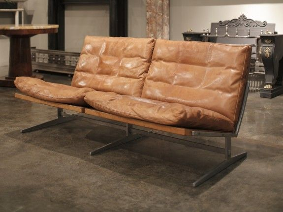 an aluminium and tan leather sofa by jorgen kastholm