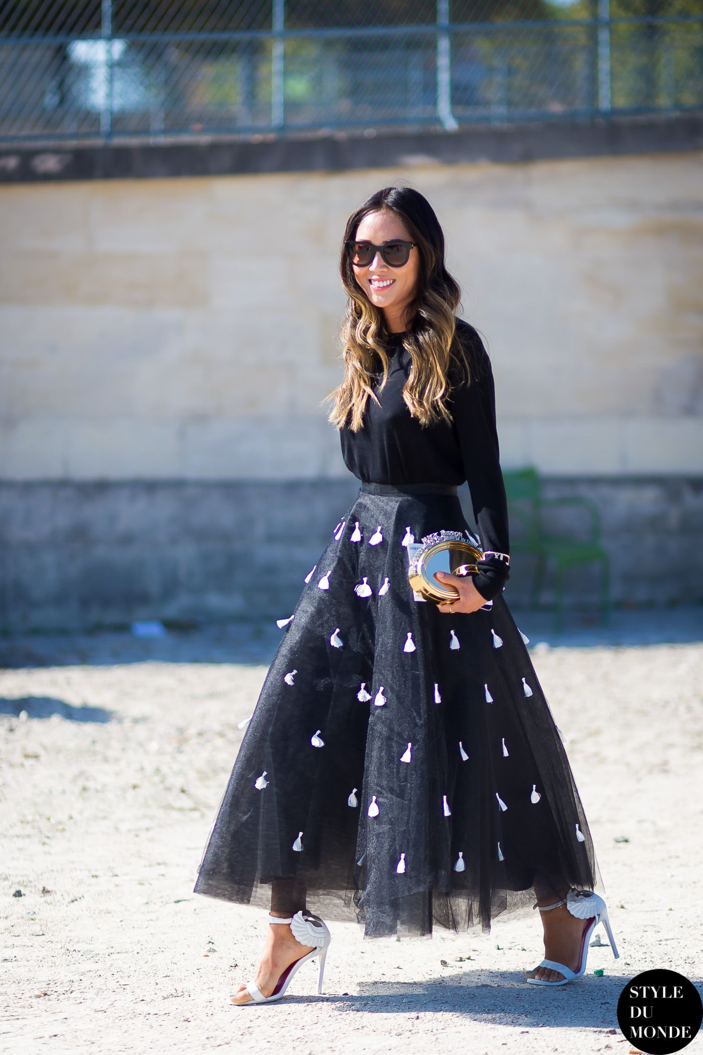 Aimee Song wearing Everlane sweater, Sachin and Babi tulle skirt, Oscar Tiye heels and Benedetta Bruzziches clutch #StreetStyle
