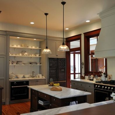 black appliances. gray cabinets. hits of black elsewhere ...