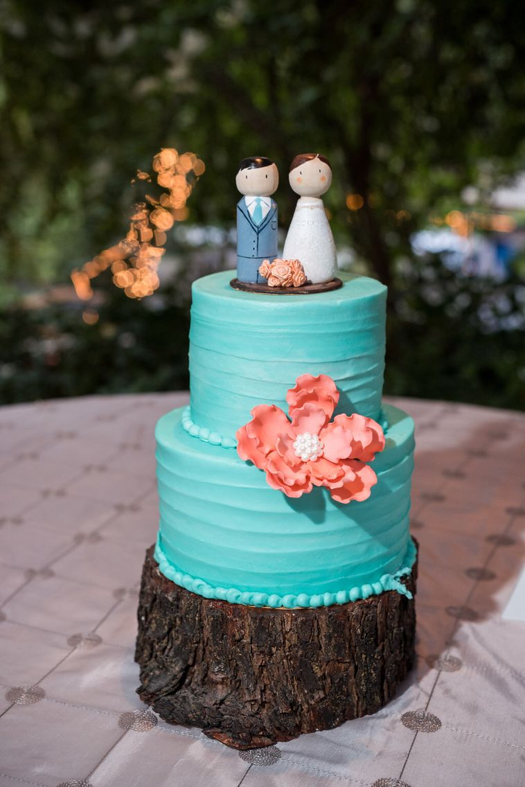 Hand made cake toppers with Tiffany blue and coral cake
