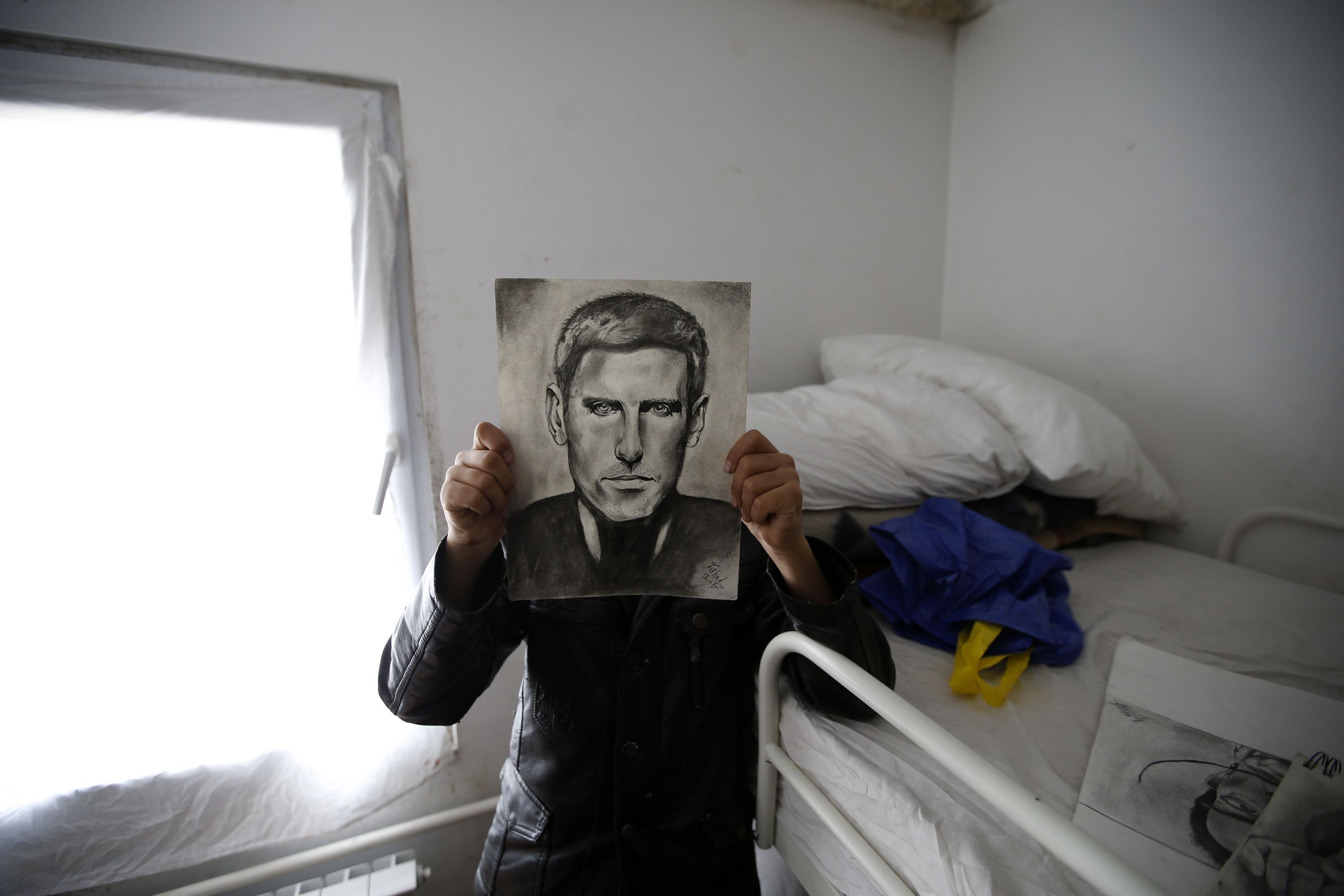 Young refugee's portraits earn him nickname of 'Little Picasso'