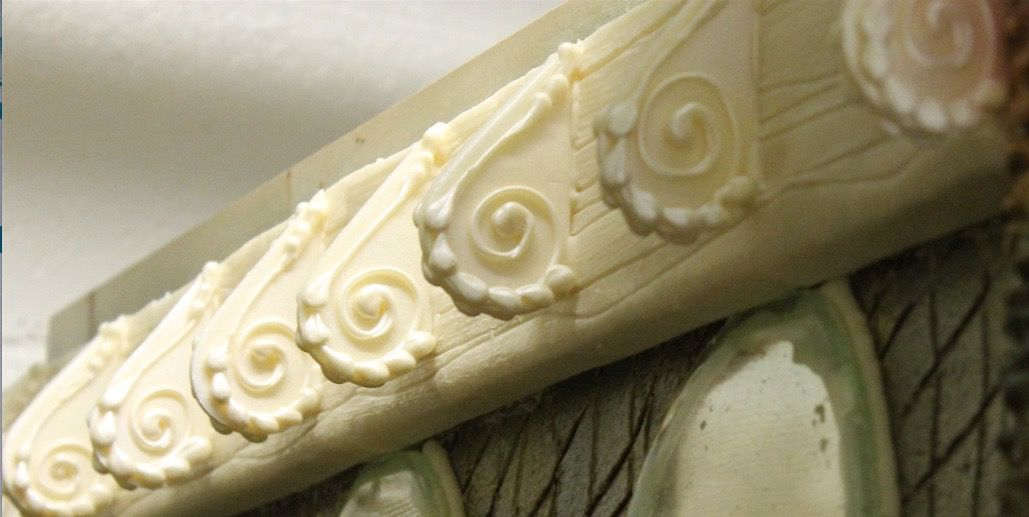 White chocolate crown moldings adorn the gingerbread castle rooftop.