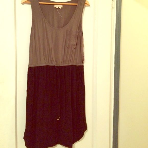 Anthropologie Color Blocked Dress an army green and black colorblocked dress from Anthropologie, gently worn Anthropologie Dresses Midi