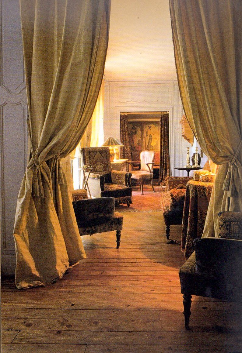 No one does gold quite like the French. Just think of Versailles. Here, a grand Parisian apartment has been elevated to an even more sophisticated level with the addition of gold silk-taffeta drapes hung theatrically between the rooms. {From Taschen's Paris Interiors book.}