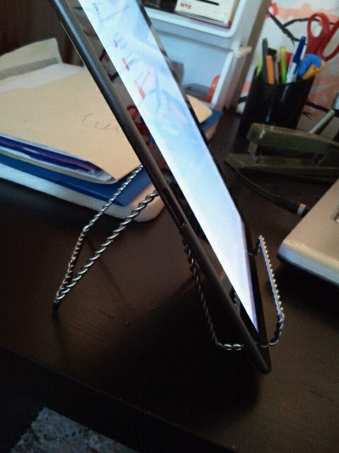 I spent $1 at Dollarama on a picture/plate stand for my tablet ...