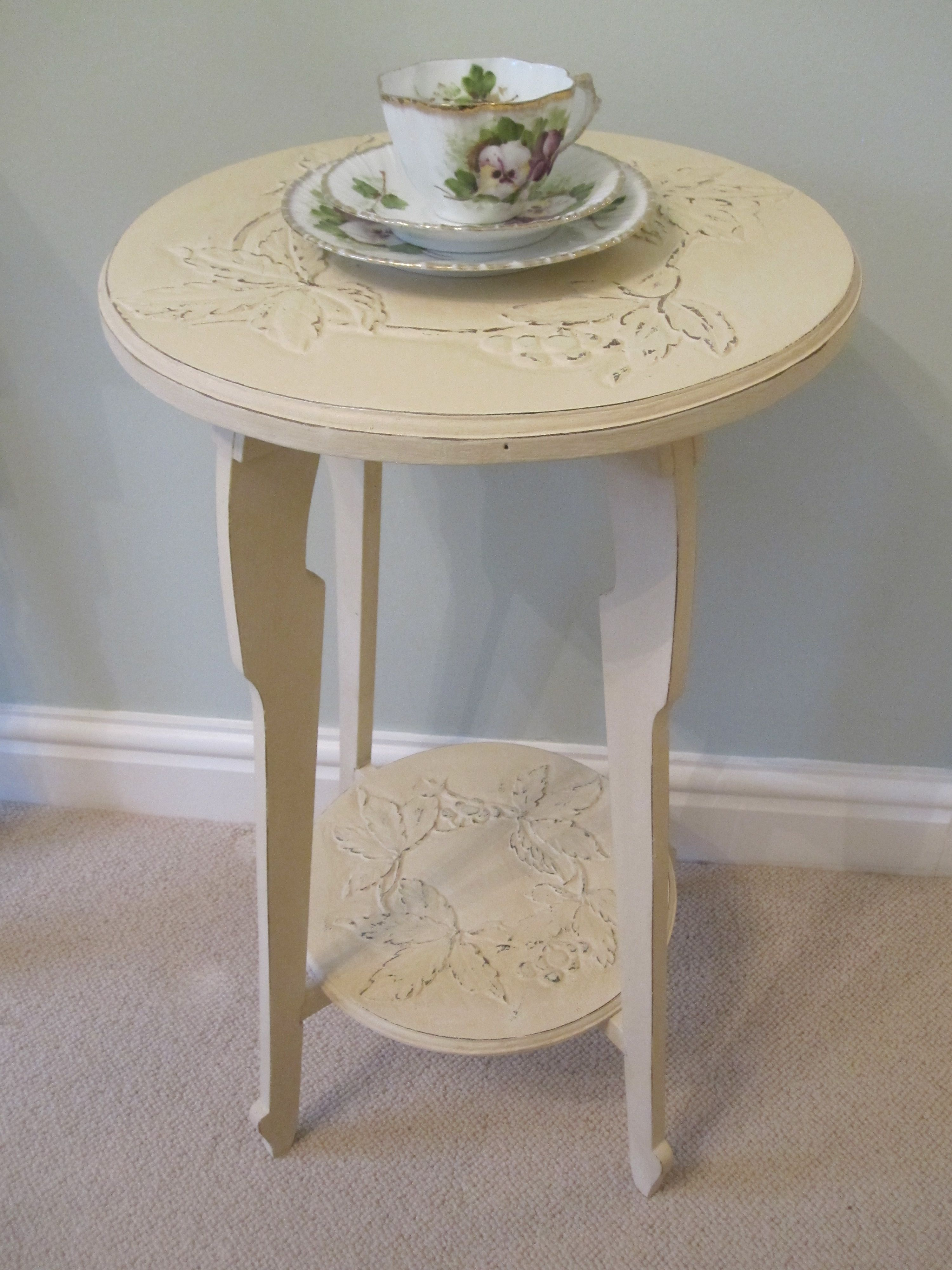 A charming vintage side table with beautiful floral carved detail, painted in Old Ochre Chalk Paint by Annie Sloan and finished with clear wax.