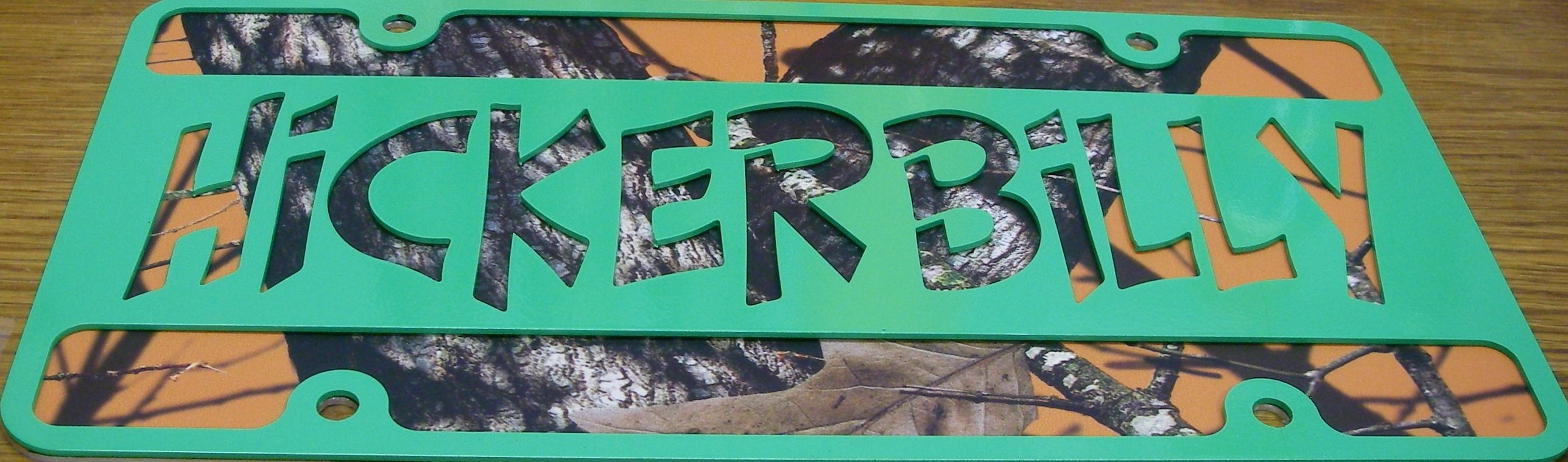 Mossy Oak Blaze Orange with Green Powder Coated Front Plate.  Buy yours today at www.hickerbilly.com