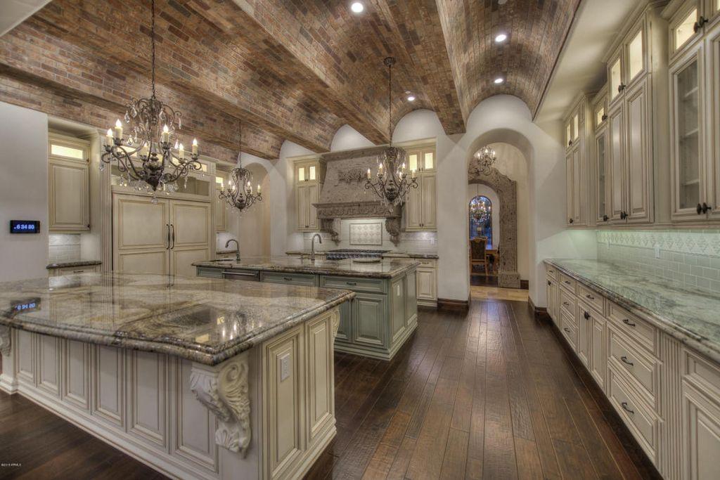 Mediterranean Kitchen With Stone Tile Chandelier U