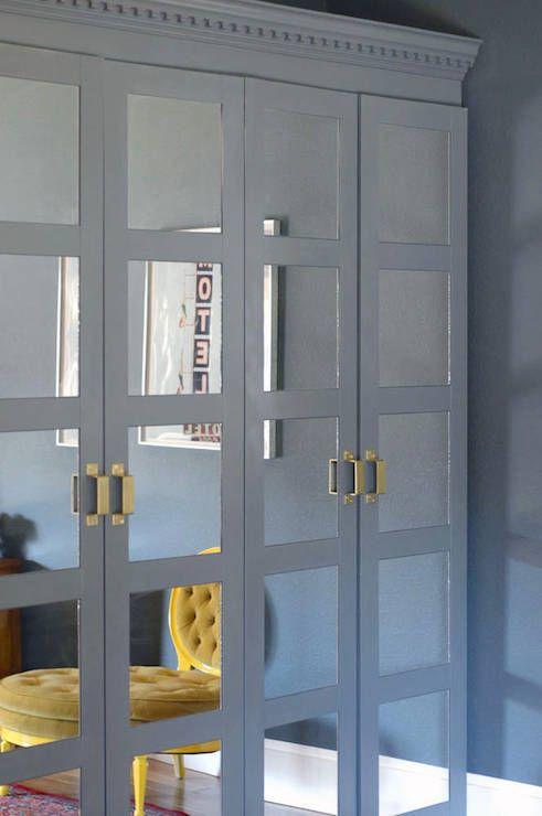 Closet features Ikea Pax Wardrobe with Ikea Bergsbo Doors
