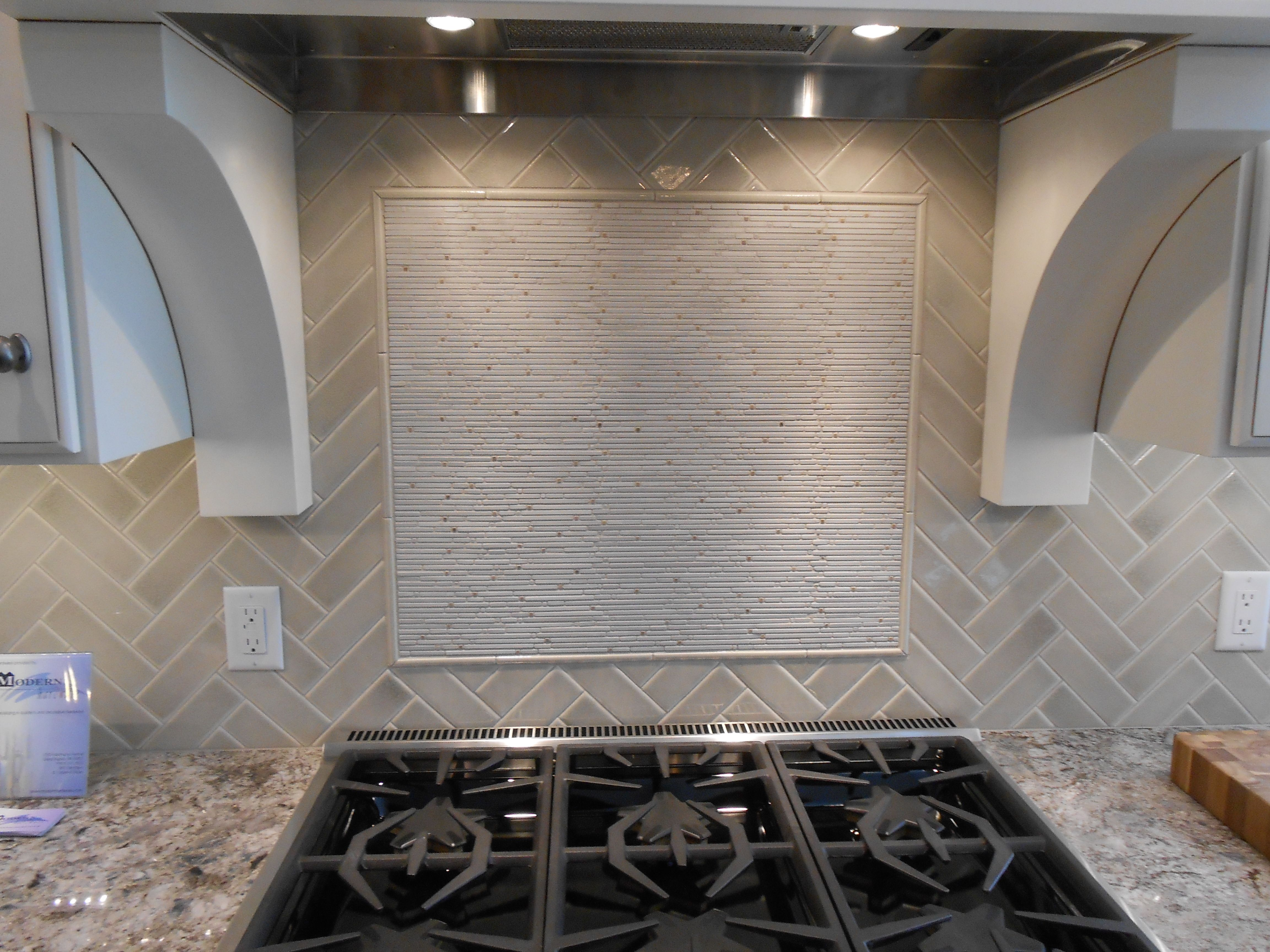 Herringbone tile with accent feature over stove | Backsplash ...