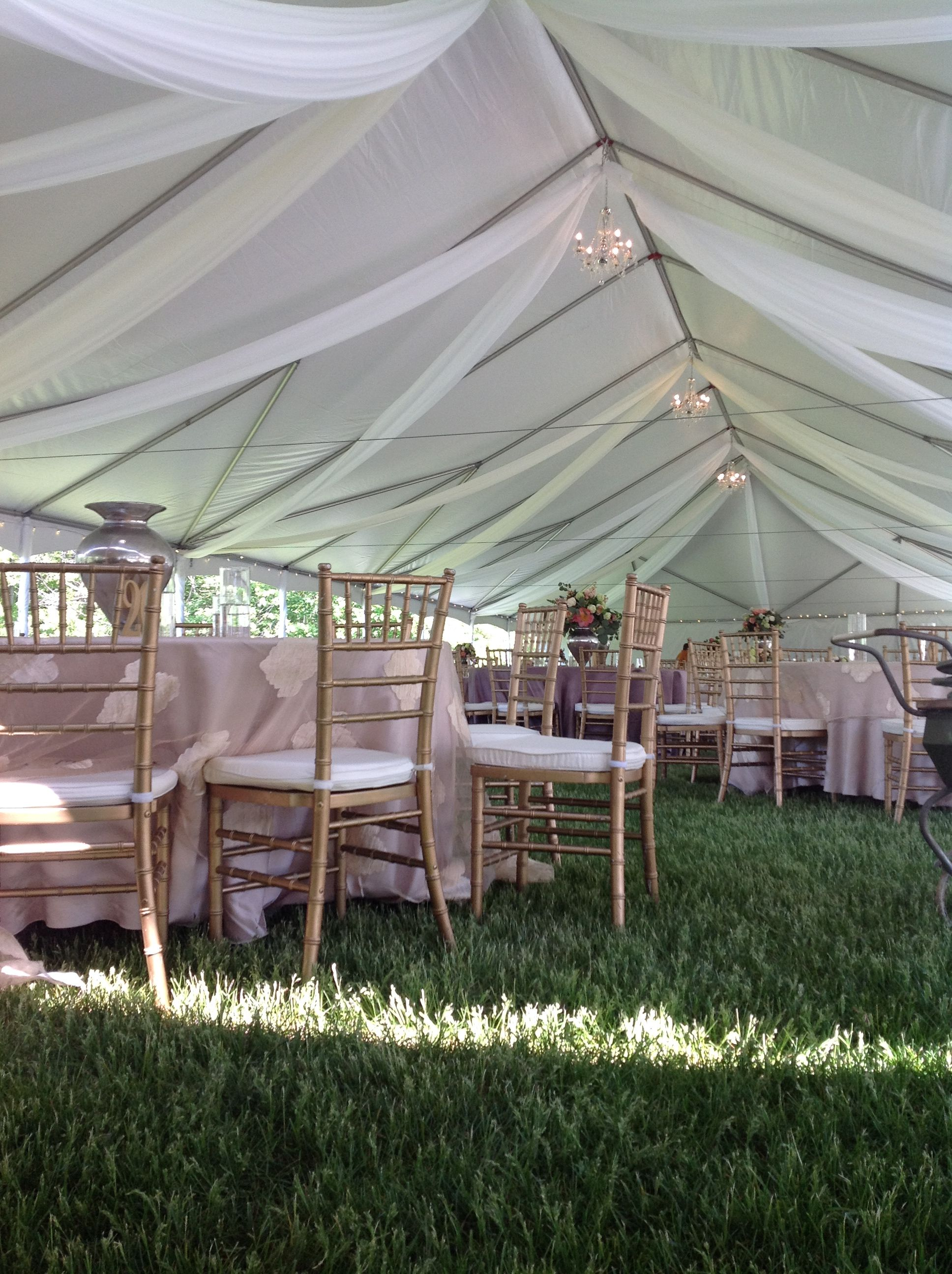 Simple draping with chandeliers give this wedding tent a ...