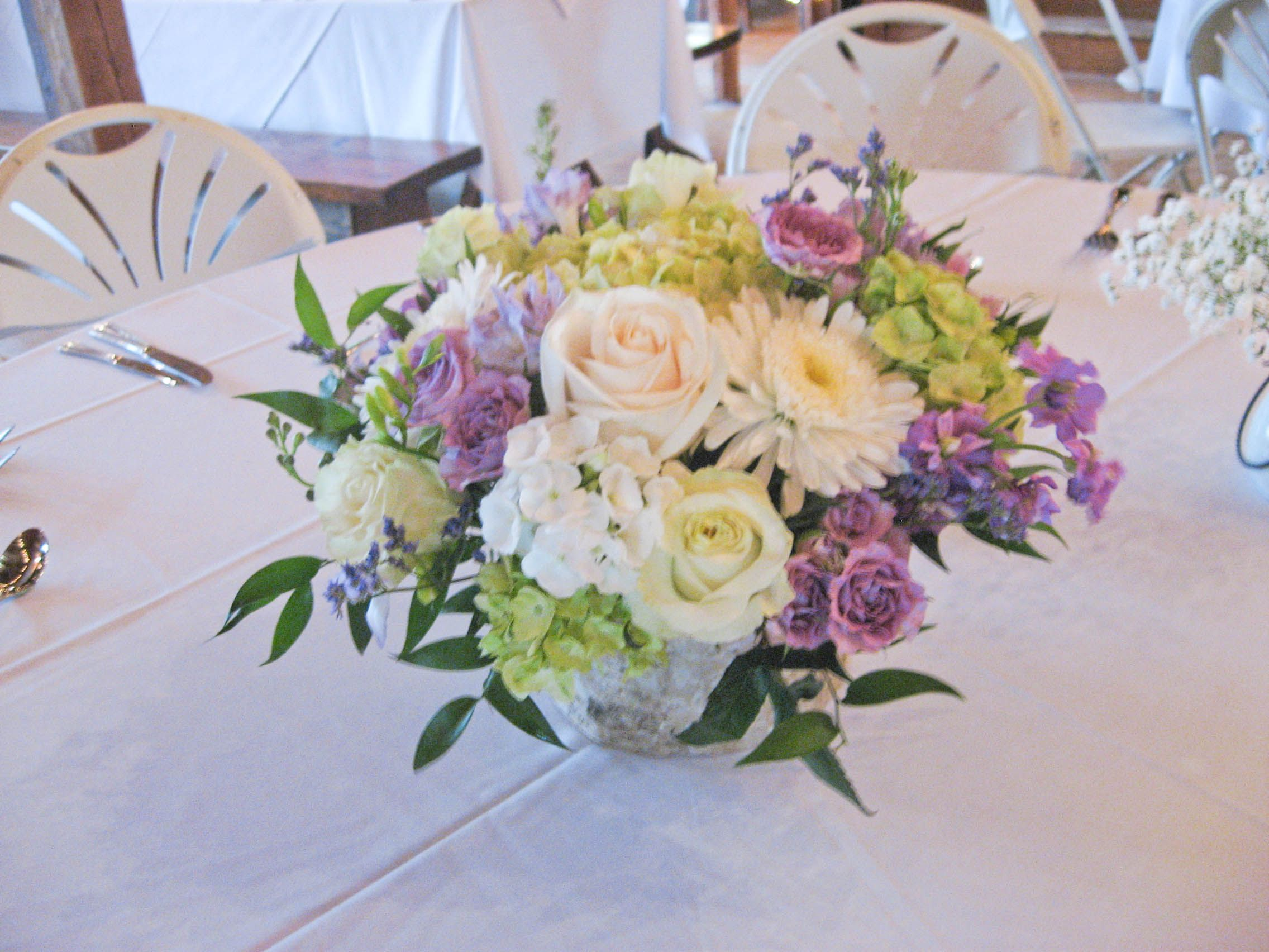 Beautiful centerpiece created with lavender white cream