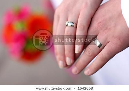 Hands With Engagement Rings On Them 37