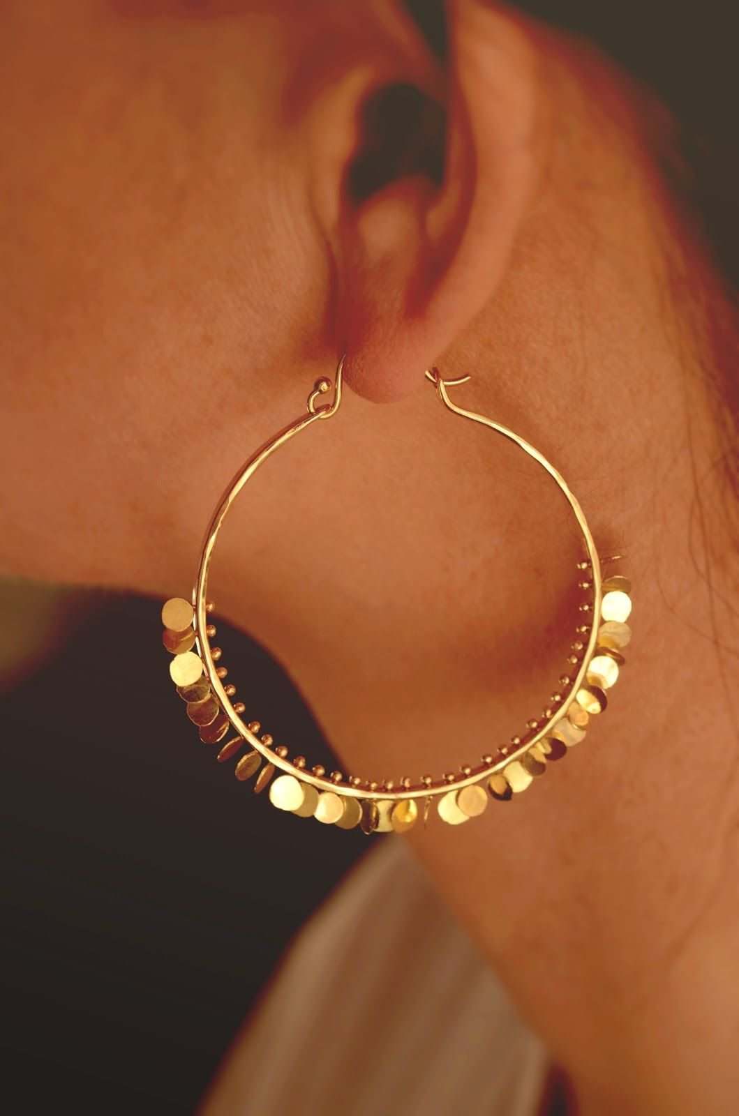 Santa Fe New Mexico jewelry designer Naomi Herndon 18k gold hoops