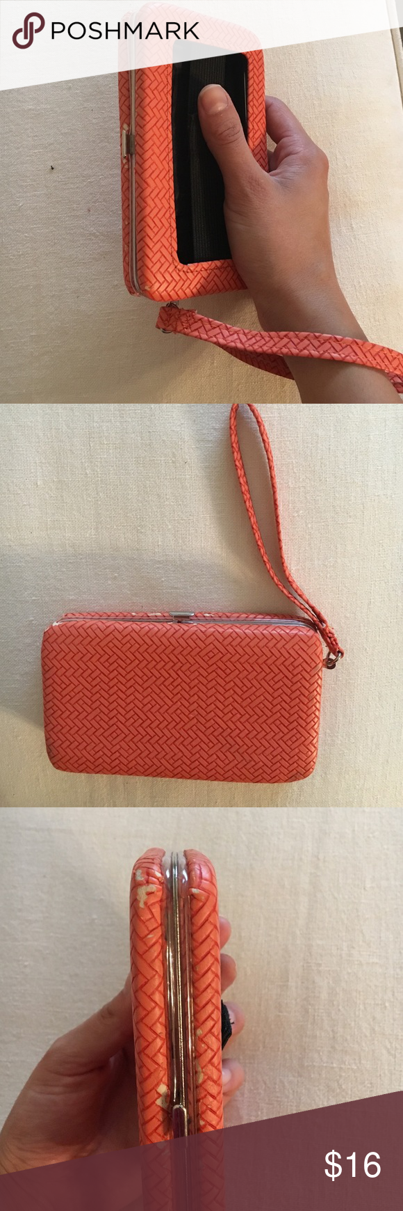 Orange Phone Wristlet Little orange wristlet perfect for the summer! Travel light with this versatile bag. can hold iPhone, Galaxy, etc. Phone slot dimensions: 3 in width, 5 in heigh, .75 in in width. 3 credit card slots, id slot. 1 cash/change slot with Velcro elastic to hold phone in place when opened. Opens and closes perfectly and can tuck in wrist strap. Little wear and tear on corners as shown but not too noticeable. Send your offers for this gem ❤️ Bags Clutches & Wristlets