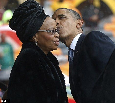 President Obama kisses Nelson Mandela's widow Graca Machel during the memorial service. The U.S. president made an emotional tribute to the ...