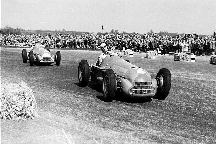 Giuseppe Farina, Alfa Romeo 158, #2, (finished 1st), leads Juan Manuel Fangio, Alfa Romeo 158, #1, (RET-oil leak), British GP, Silverstone, 1950.
