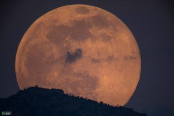 Spooky 'Honey' Moon Casts Glow on Friday the 13th (Photos) by Nina Sen, Space.com Contributor       June 13, 2014 07:20am ET