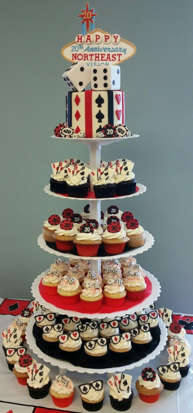 Cake and cupcakes for a casino themed 20th anniversary