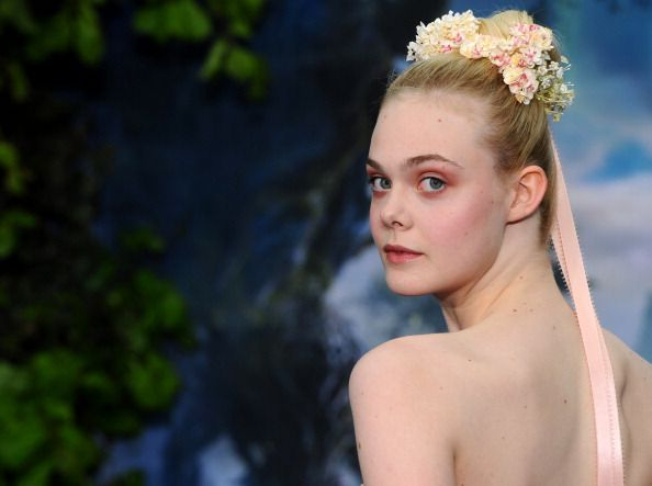 Elle Fanning attends a private reception as costumes and props from Disney's 'Maleficent' are exhibited in support of Great Ormond Street Hospital at Kensington Palace on May 8, 2014 in London, England