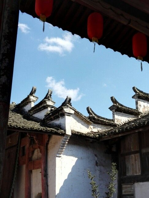 White cloud, blue sky, old village