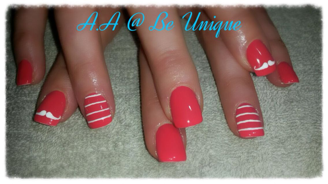Nails done by Angelique Allegria.  #coral #Mustache #stripes #BeUnique @angiedsa