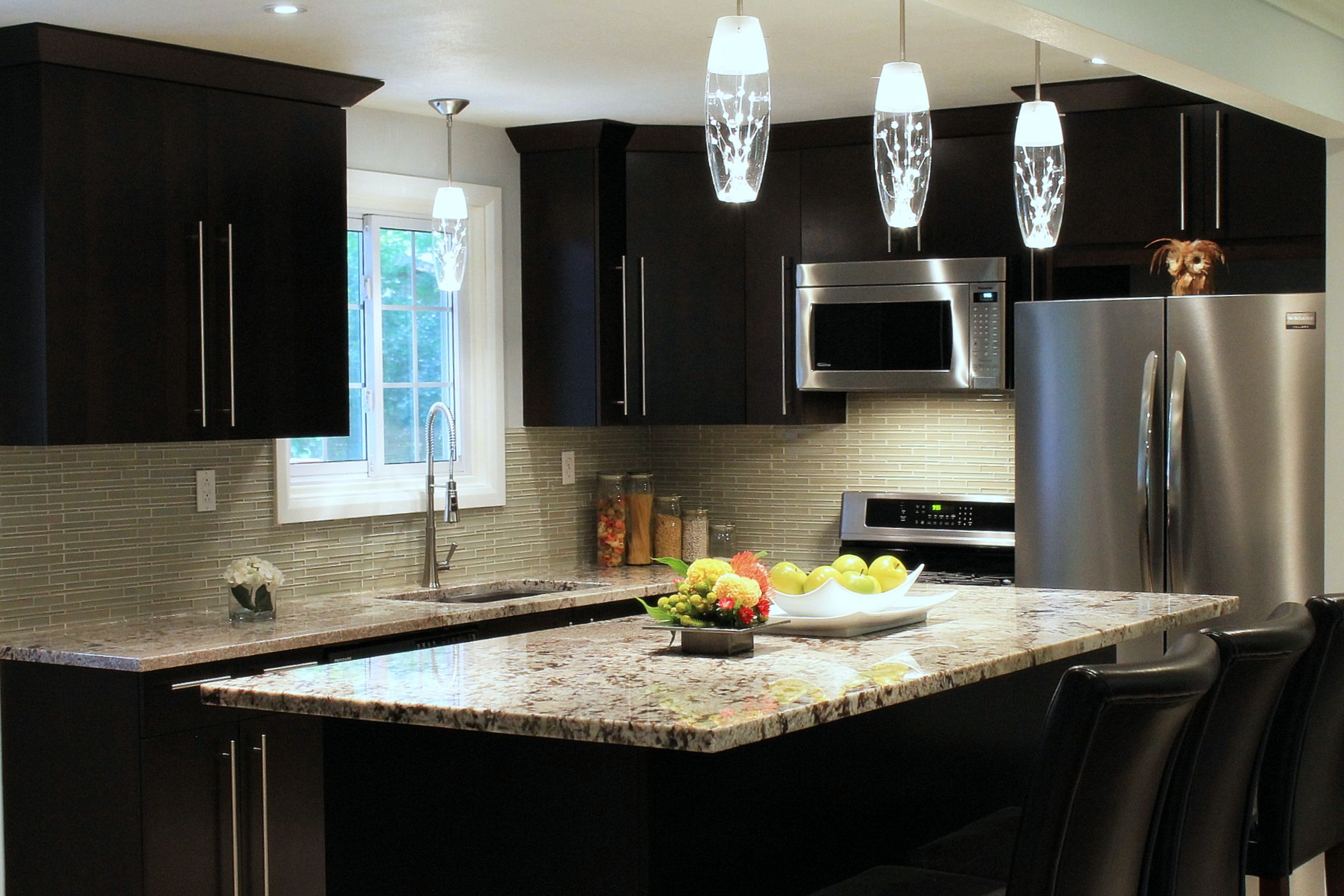 Crisp And Clean Custom Flat Slab Maple Doors In A Dark Chocolate Stain With Brushed Stainless Steel Appliance Linear Glass Tile Glass Tile Backsplash Kitchen