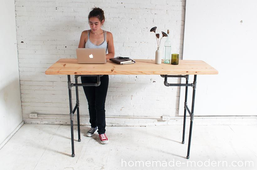 Make a standing desk out of wood and plumber's pipe with HomeMade Modern.
