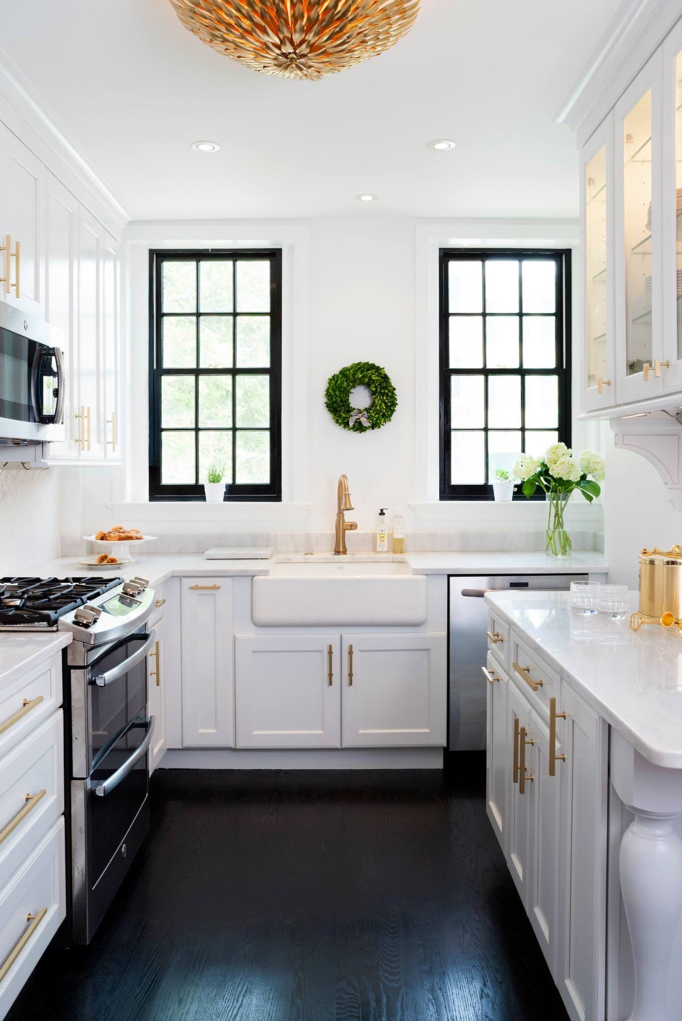 White Kitchen Cabinets With Brass Hardware New Super White Countertops Black Wood Floor White Kitchen Design Kitchen Design Kitchen Countertops