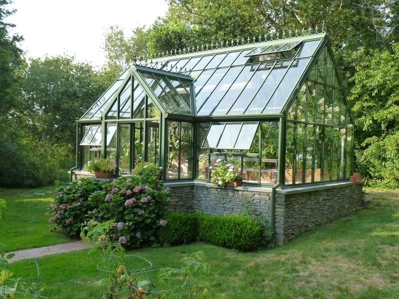 Small Sturdy Greenhouse With Glass Windows And Rain