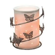 """The butterfly Silhouette Collection. It glows when lit. 5.5"""" tall available on line. $ 40.00 warmer + wrap. Get it at : www.katmills.scentsy.us"""