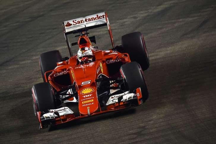 © Provided by AFP Ferrari's Sebastian Vettel won the Singapore Grand Prix on September 20, 2015