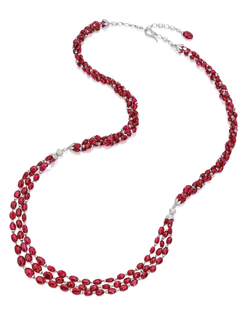 Ruby and diamond necklace: The triple-strand necklace composed of ruby beads together weighing approximately 295.00 carats, spaced by diamond-set rondelles, embellished by diamond-set bead caps and clasp, the diamonds together weighing approximately 9.30ct, mounted in 18k white gold, length approximately 800 to 840mm. (via Sothesby's)