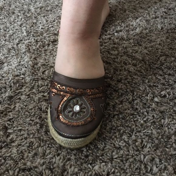 Wedge brown shoes with jewels on top Wedge brown with with sequins and jewels worn one time in mint condition Shoes Wedges