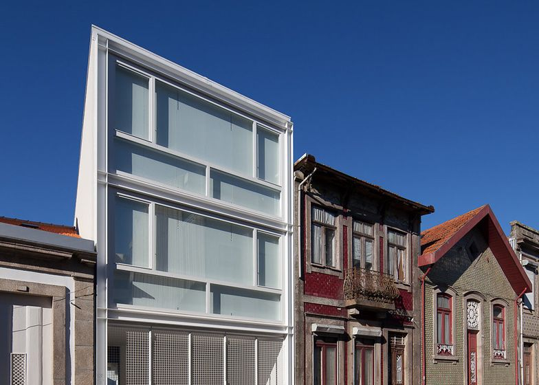 Folding shutters create varying privacy for Porto townhouse