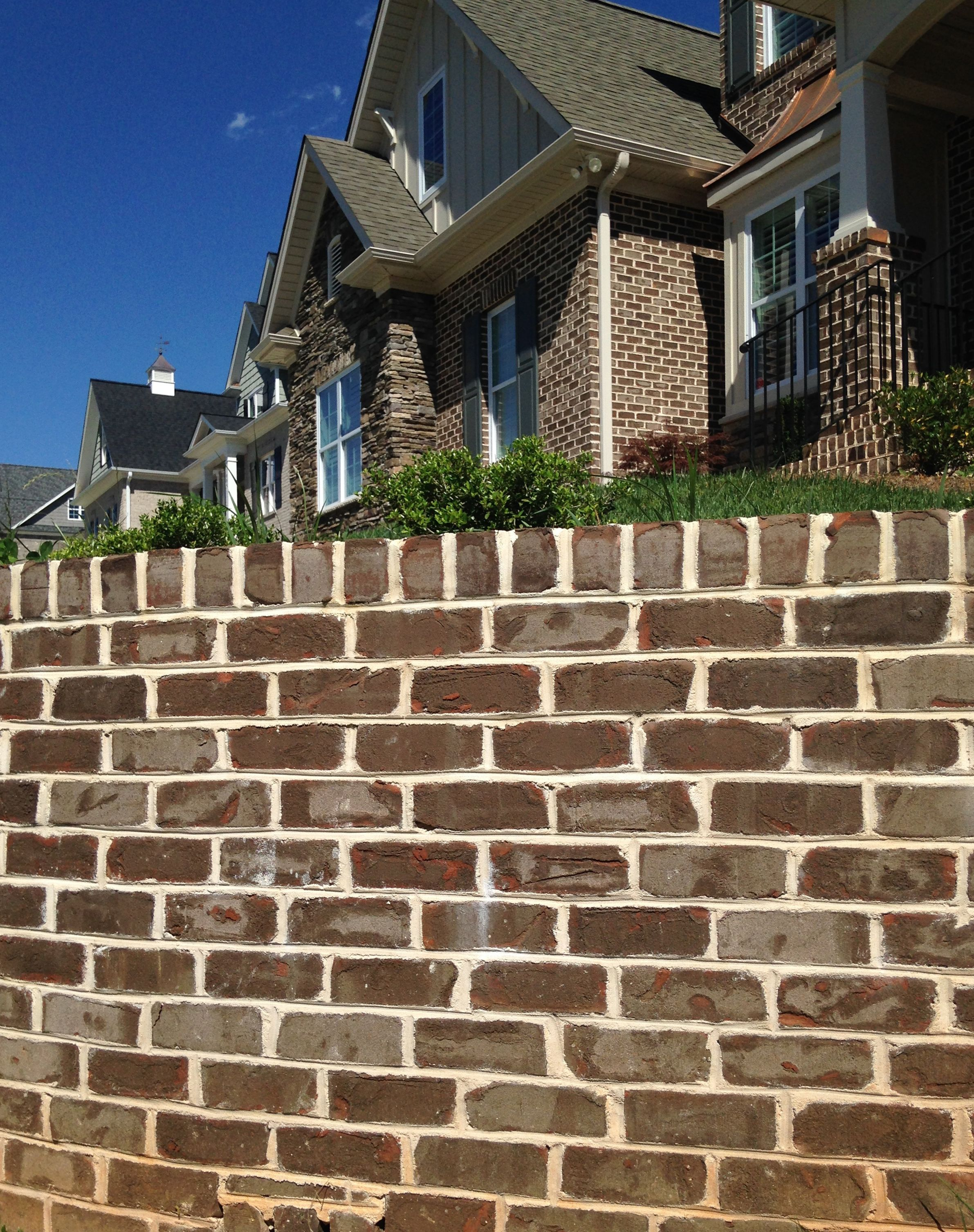 Retaining Wall Matches Home Exterior. Casa Grande Facebrick With Sand And  White Mortar Made By