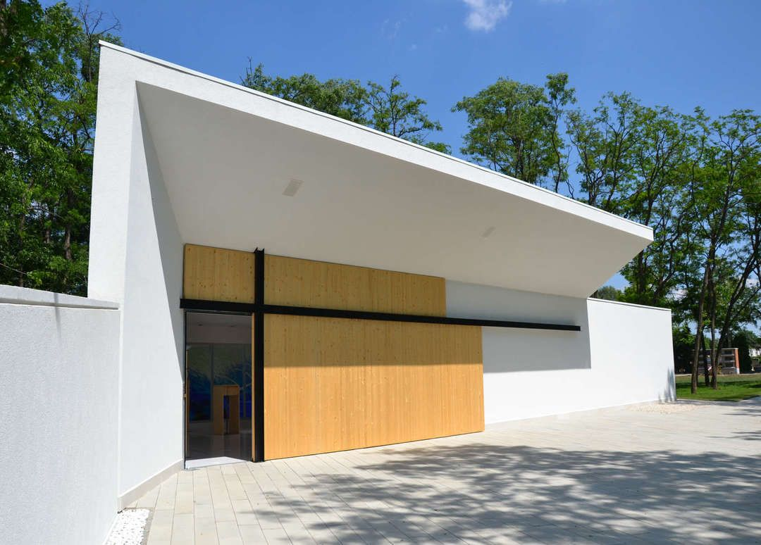 After architecture l art s funeral chapel forms a modern - Modern funeral home interior design ...